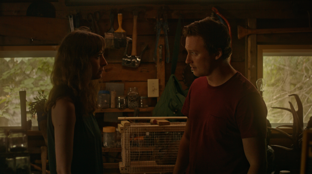 Miriam and Dylan have a heated confrontation in a boat house.